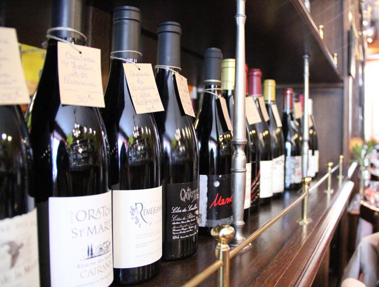 Wall of wines at Les Papilles Paris