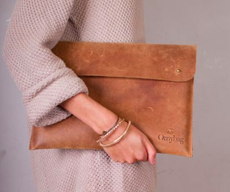 Eco-leather laptop case that can double as a clutch