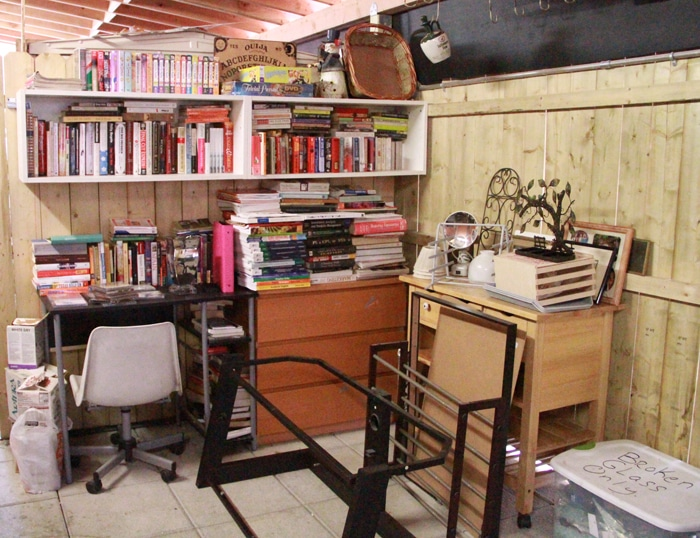 A corner serves as a lending library and mini flea market for the building
