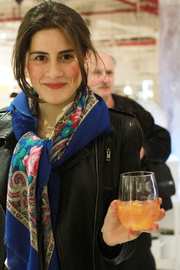 Lauren Singer of Trash Is for Tossers drinking a fruit cocktail at the CSA celebration