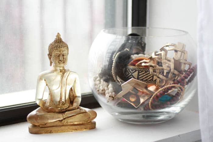 Buddha from ABC Home and a flower vase full of bracelets.