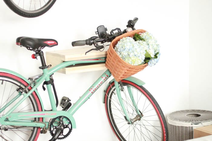 Hanging bikes on the wall and putting flowers in the basket