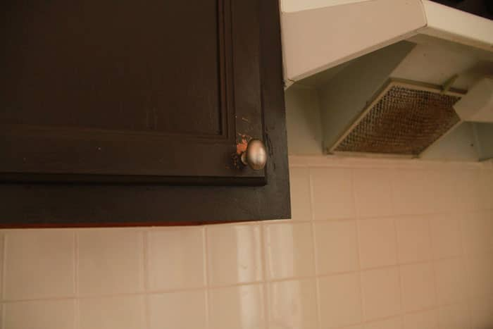 Wear and tear on kitchen cabinets before pitcture