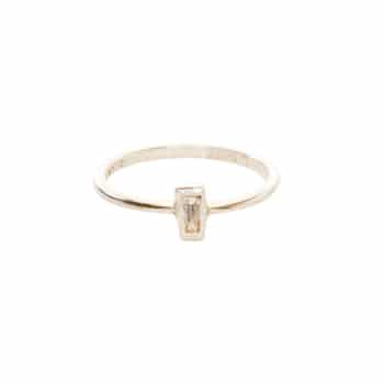 14k gold band with tapered baguette diamond.