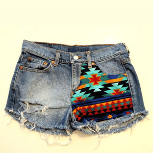 Non-exploitative festival fashion // Upcycled denim shorts donates to education in Africa & the Carribbean