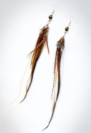 Non-exploitative festival fashion // Earrings handmade in the U.S. from cruelty-free feathers.