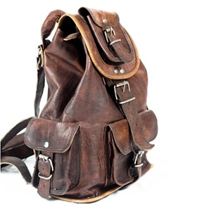 Non-exploitative festival fashion // Naturally tanned leather bag handmade by Indian artisans.