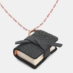 Write a sweet something in this book necklace before you give it to her.