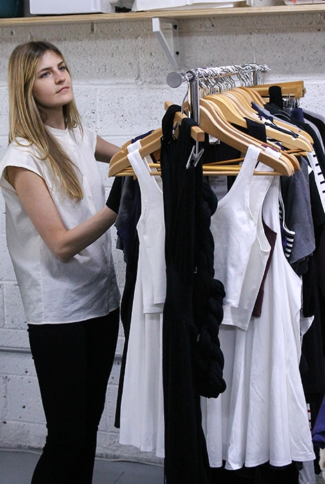 Renee Peters of Model 4 Green Living sorts through the incoming fashion before the swap.