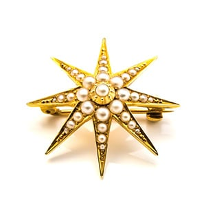 Antique pearl and gold star brooch