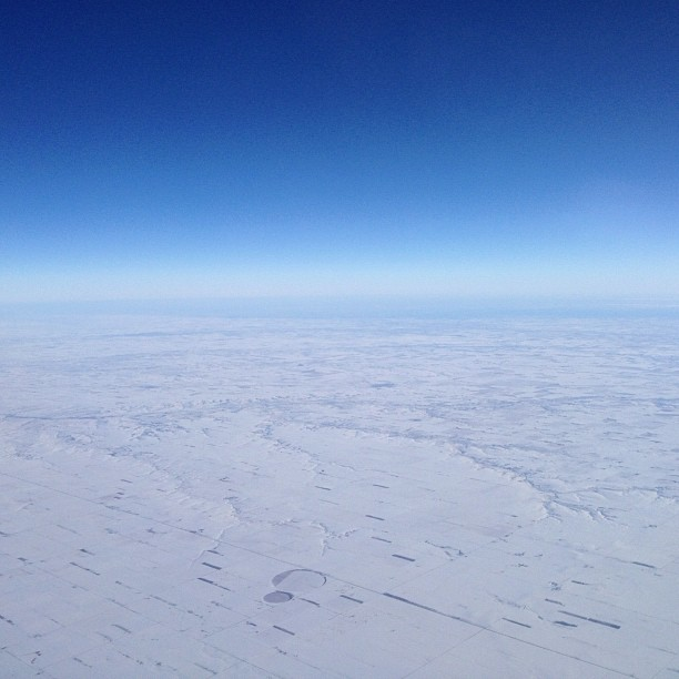 View of west and snow from plane
