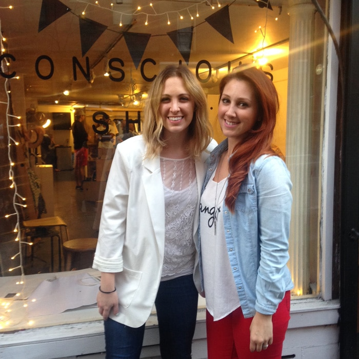 Rachel and Elena of Conscious Magazine, in front of their pop-up