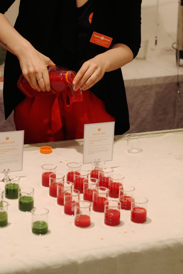 Organic Avenue juices in small beakers.