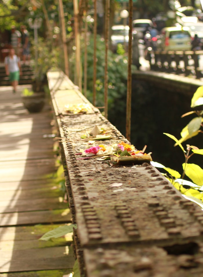 Offerings on a rusty bridge in Bali