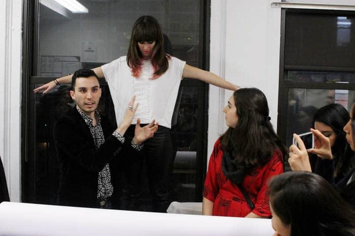 Daniel Silverstein demonstrates zero waste design on a shirt worn by Alden Wicker
