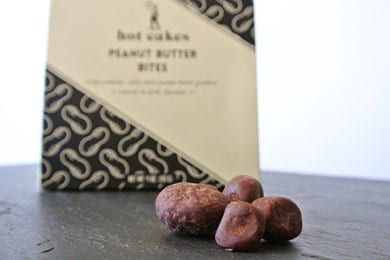 """For the peanut butter lover: Chocolate peanut butter bites.  Made with an extra helping of sea salt harvested from the West Coast, coated in organic dark chocolate, and dusted with dark cacao powder, they'll make your date go, """"Reese's who?"""""""