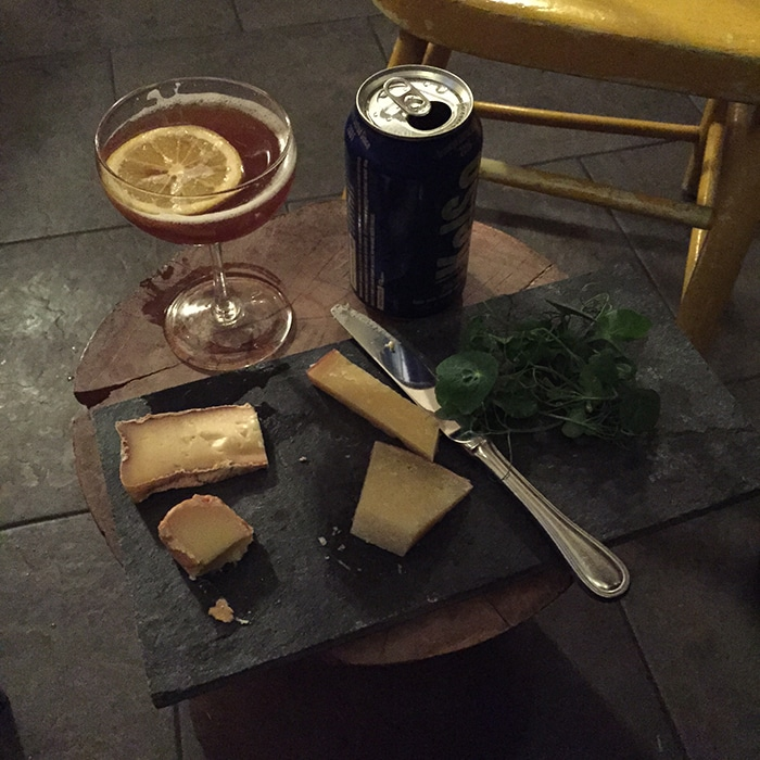 Cast-off cheeses from Whole Foods, a cocktail made from odds and ends