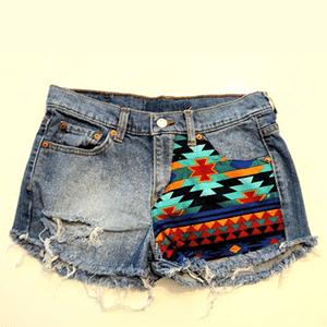 Non-exploitative festival fashion // Upcycled denim shorts donates to education in Africa & the Carribbean