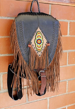 Non-exploitative festival fashion // Fringe backpack made by Guatemalan artisans