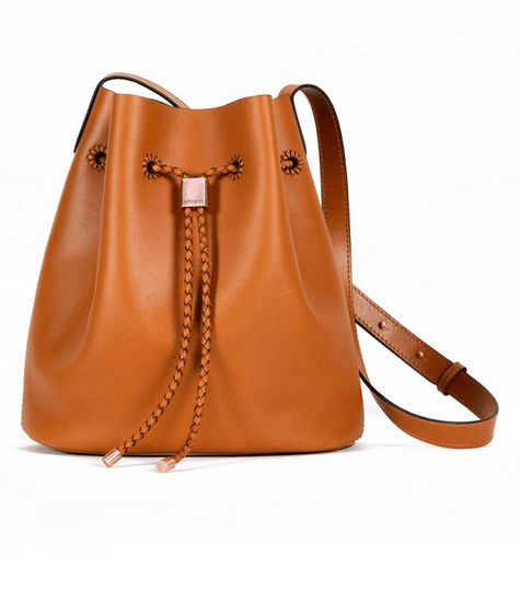 Vegetable-tanned leather bucket bag made by master artisans in India