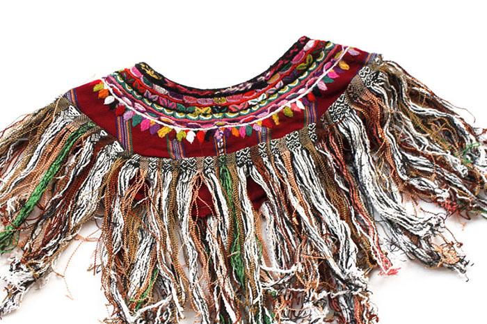 A vintage huipal collar from the village of Patzun. Handmade with 100% authentic Mayan embroidery. This item is woven on a traditional backstrap loom by a female artisan and has also been worn by a Mayan woman in Guatemala.