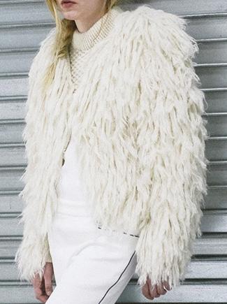 A sheepwool jacket andknit by Peruvian artisans.