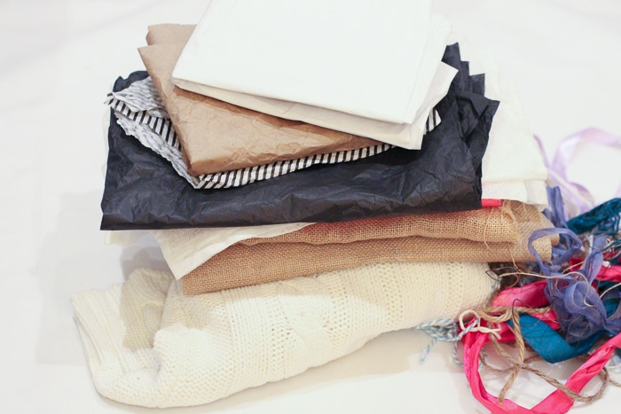 Eco-friendly gift wrap tip: save up tissue paper, ribbons, and even old sweaters to use at Christmas time