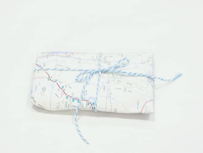 Eco-friendly gift wrap idea: Get an old map of some place significant to the recipient. This map of Nevada has Black Rock Desert from Burning Man on the top!