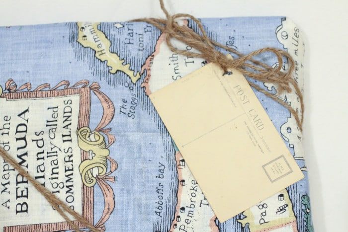 Eco-friendly giftwrap idea: Vintage tea towel and post card from antique shop with twine