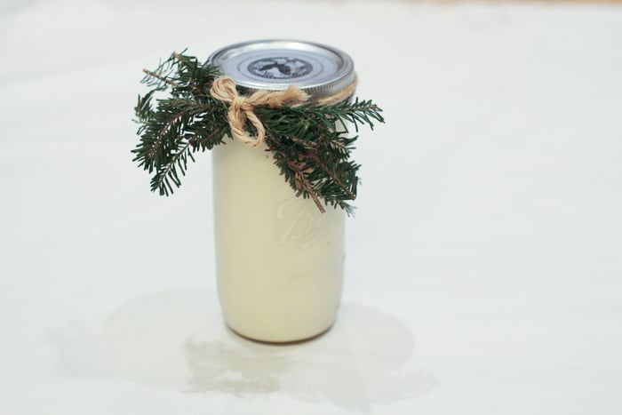 Eggnog decorated with twine and pine tree sprigs