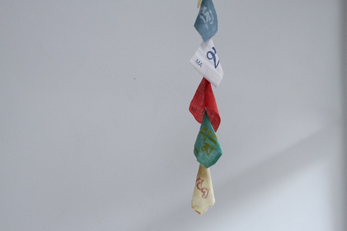 Prayer flags hanging above her dining room table.