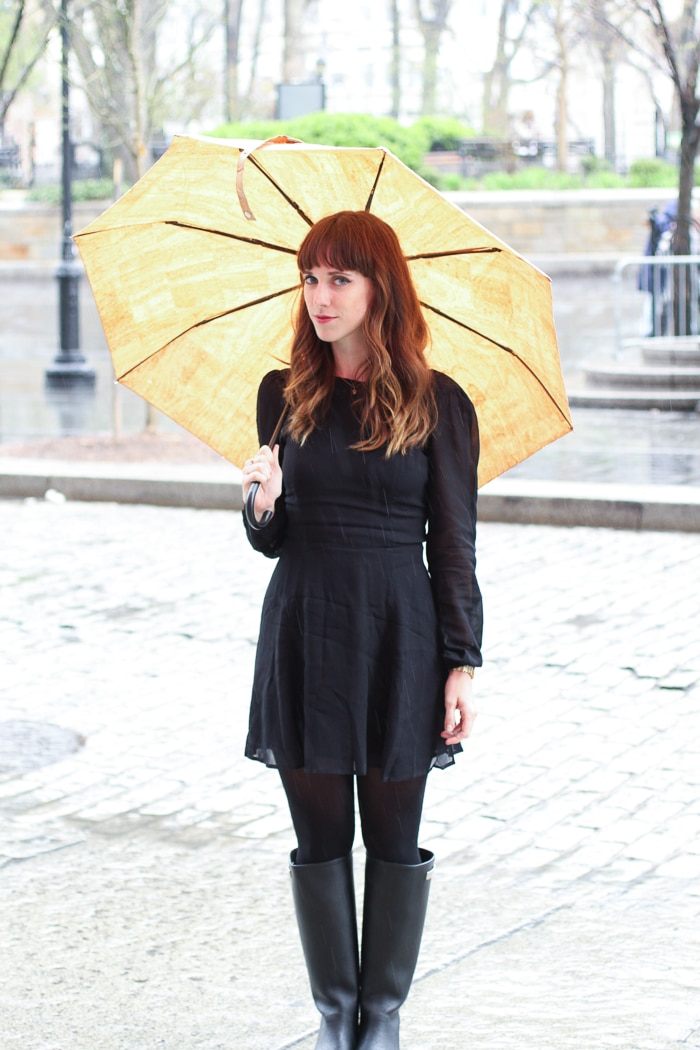 Alden Wicker of EcoCult wears a Reformation dress, Alice & Whittles boots, Swedish Stockings tights, and a Pelcor umbrella