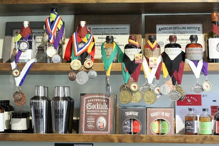 Hudson whiskeys draped with awards.