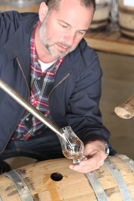 Pulling whiskey straight from the barrel. That will knock you back!