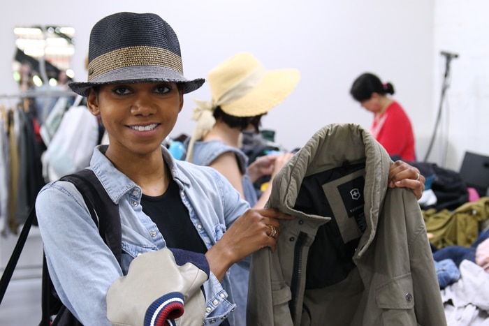 Designer Tabitha of Tabii Just holds up the perfect army green jacket she found.