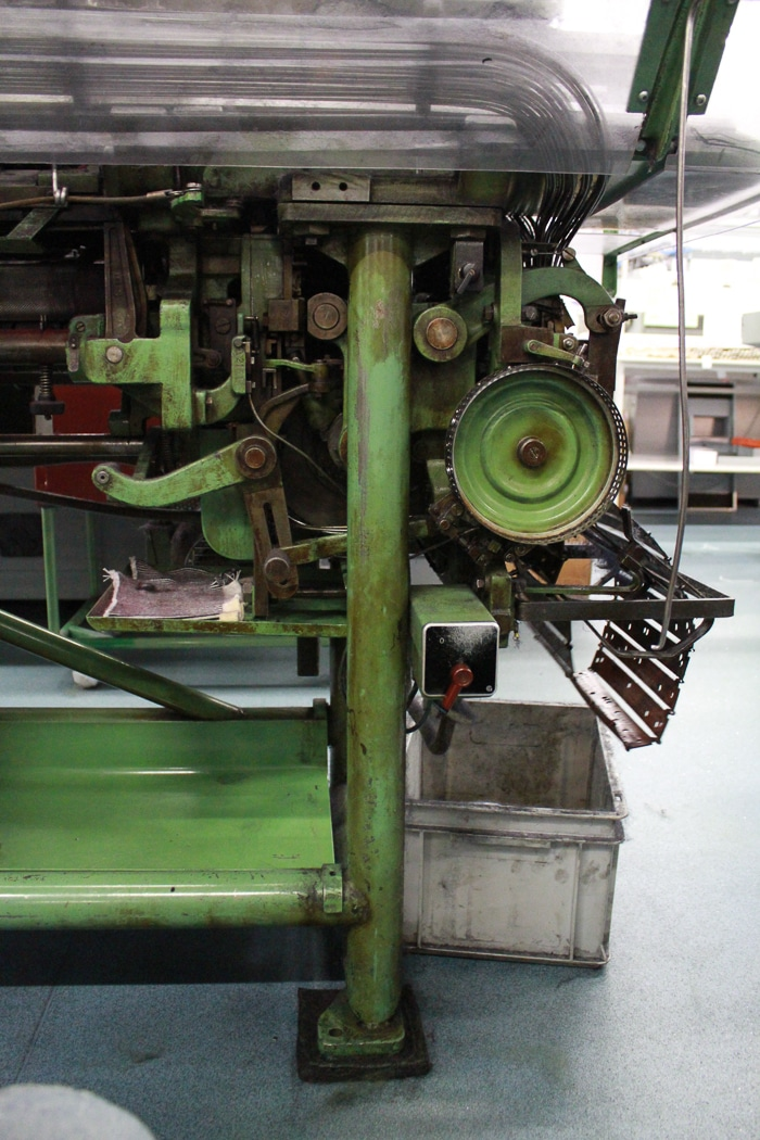 An antique knitting machine in the Saint James factory