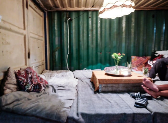 A nook inside a shipping container for relaxing, at Pllek