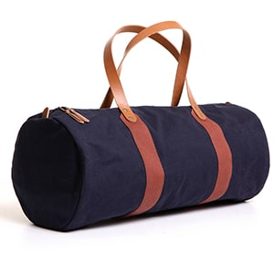 Give him a reason to plan a weekend trip with this vegetable- tanned leather and cotton bag made in Colorado.