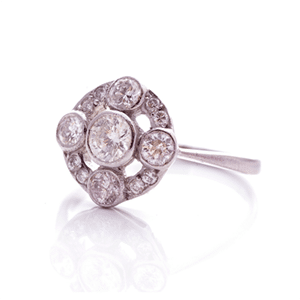 Pre-loved white gold and diamond halo ring
